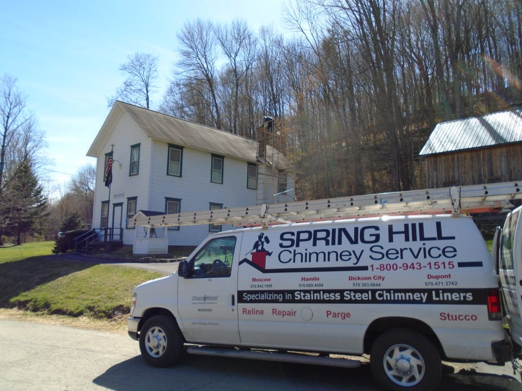 Spring HIll Chimney Service working at Greene-Dreher Historical Society